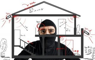 Burglar Looking At House Plan On Glass With Security Accesses Marked With Red Marker