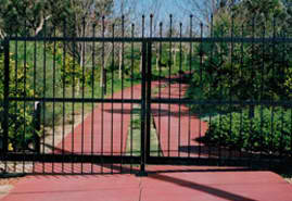 Black Steel Driveway Gate At Garden Entrance