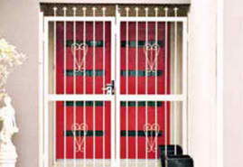 White Color Security Bars On Home With Red Doors