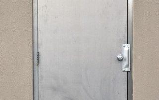 Heavy steel exterior security door.