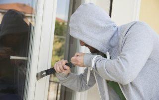 Bugler Trying To Break In By Opening Door Lock With A Steel Rod
