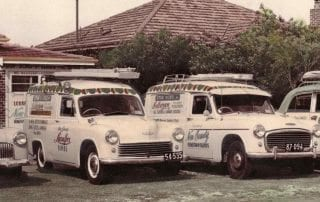 Four Stand Bond Vintage Service Vehicles Parked On Lawn