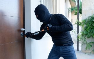 A Burglar Breaking Door Lock Using A Crowbar
