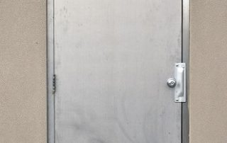Heavy steel exterior security door.